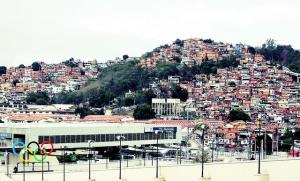 Rio De Janiero, the Olympic Rings alongside a favela. Credit - Andy Miah