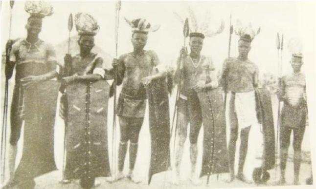 Courtesy of The Nigrizia,1932, (Comboni Missionary Magazine). Picturing dancers preparing for the Otole