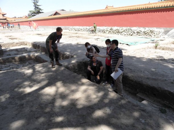 The Durham and Palace Museum team discussing the stratigraphy of the excavations. (Photo Courtesy of Jack Smith, RCUK China)